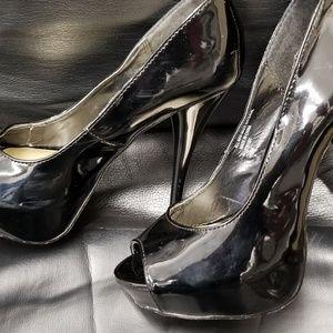 Heels.  Black patent